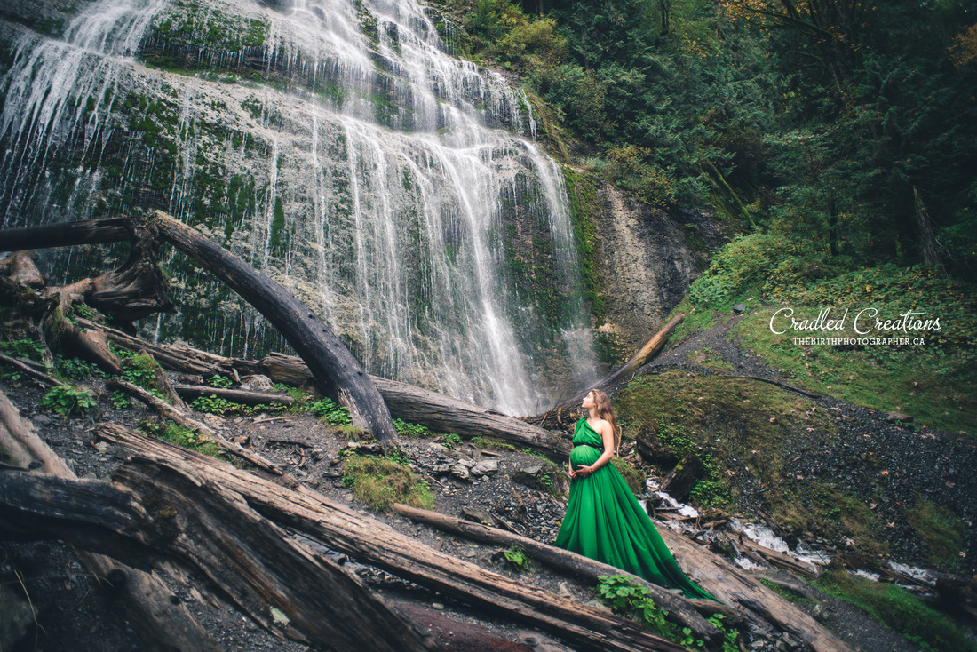 maternity gown pregnant by waterfall