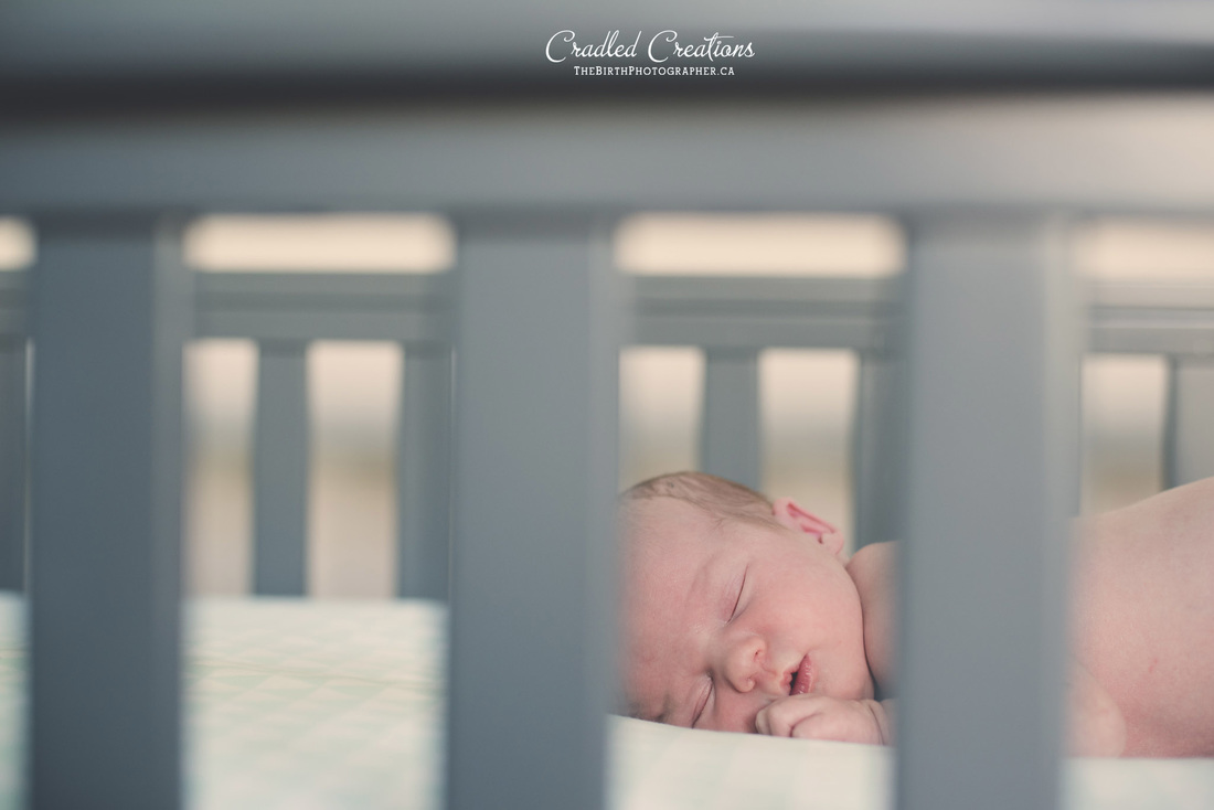 Newborn in his Crib.