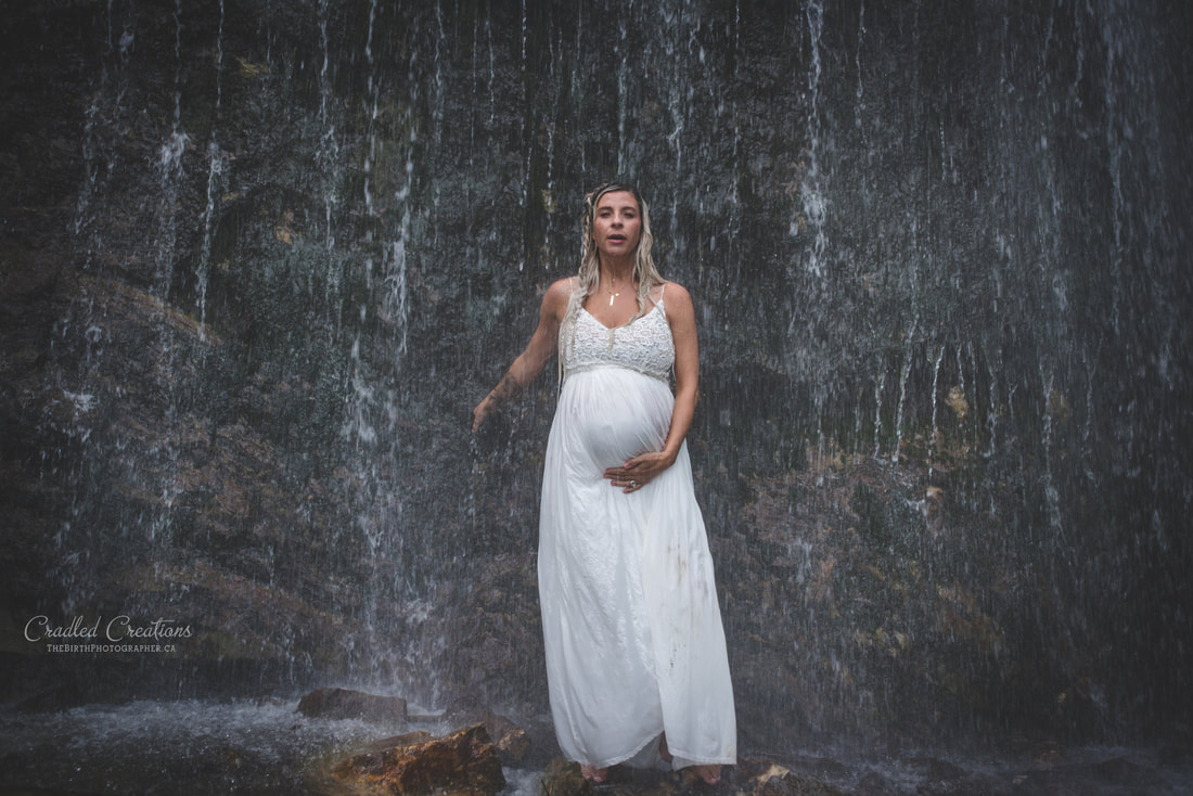 maternity photos in water, waterfall, rain