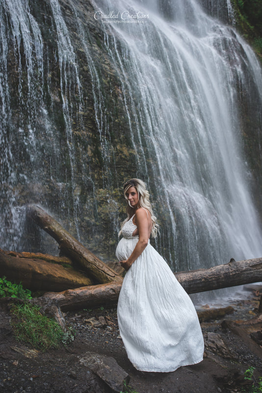 maternity photos under waterfall, in rain